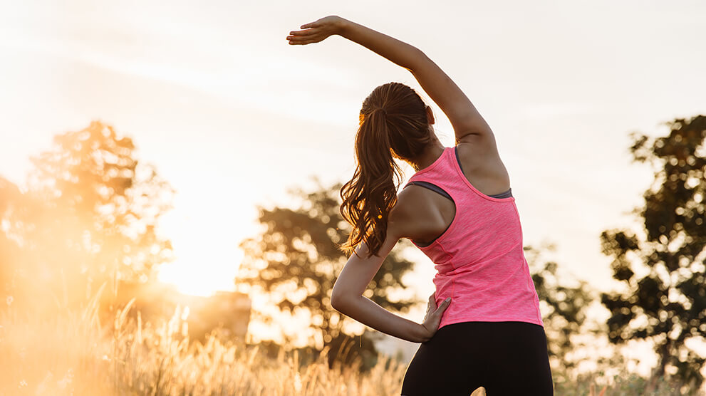 Woman doing yoga outside in morning