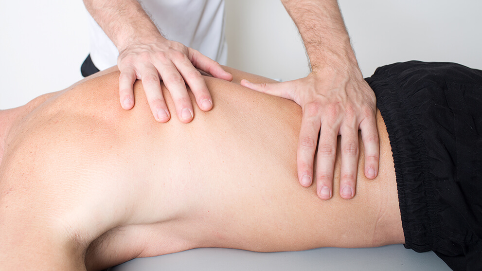 Man getting myofascial release massage treatment