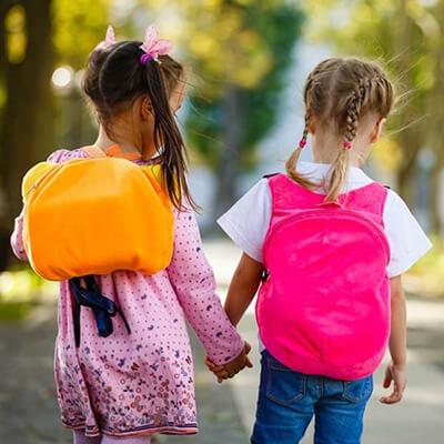 Little girls walking holding hands