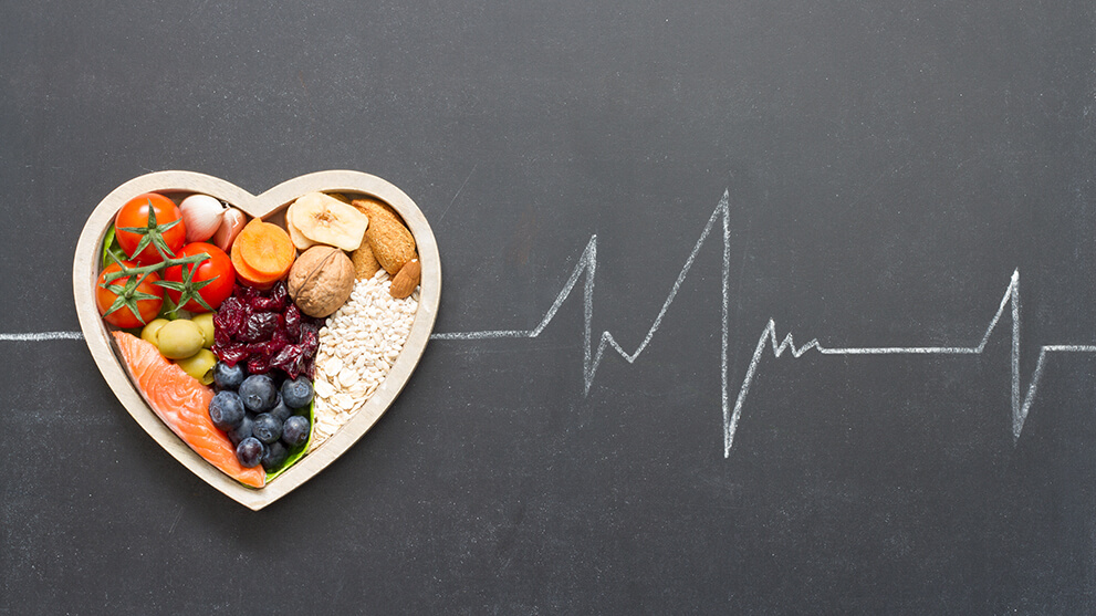 Healthy foods in heart shaped bowl